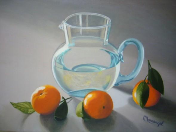 Jarra con agua y mandarinas