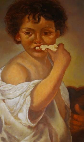 Niño comiendo pán